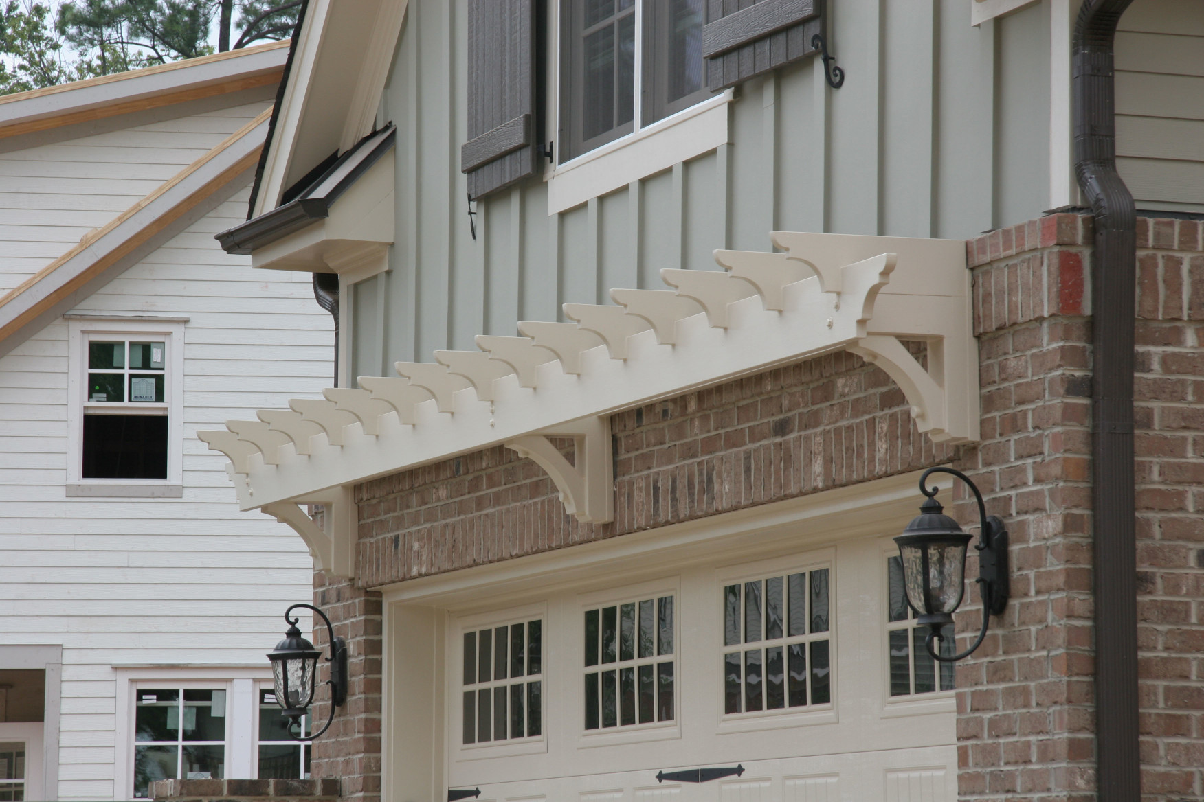 This wood trellis with stain adds curb appeal to the exterior of this home.