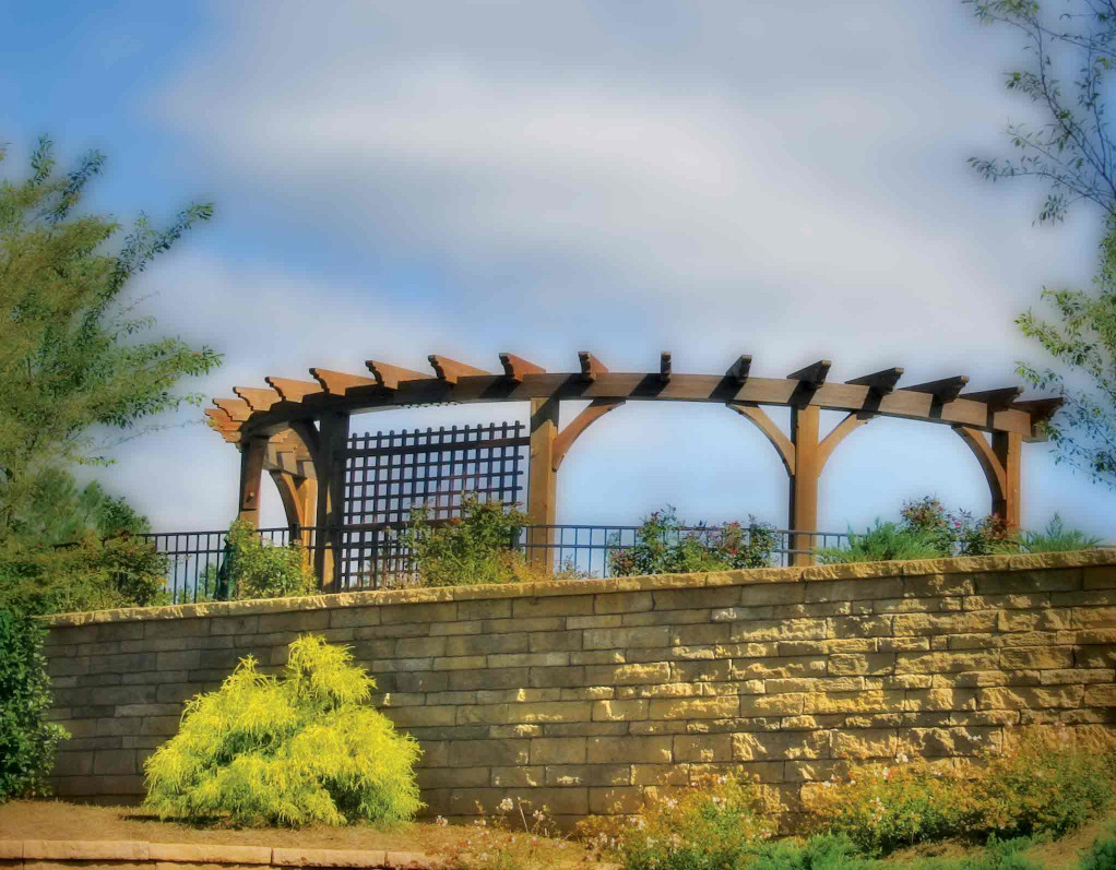 This custom designed wood trellis feature is a great addition to this neighborhood.
