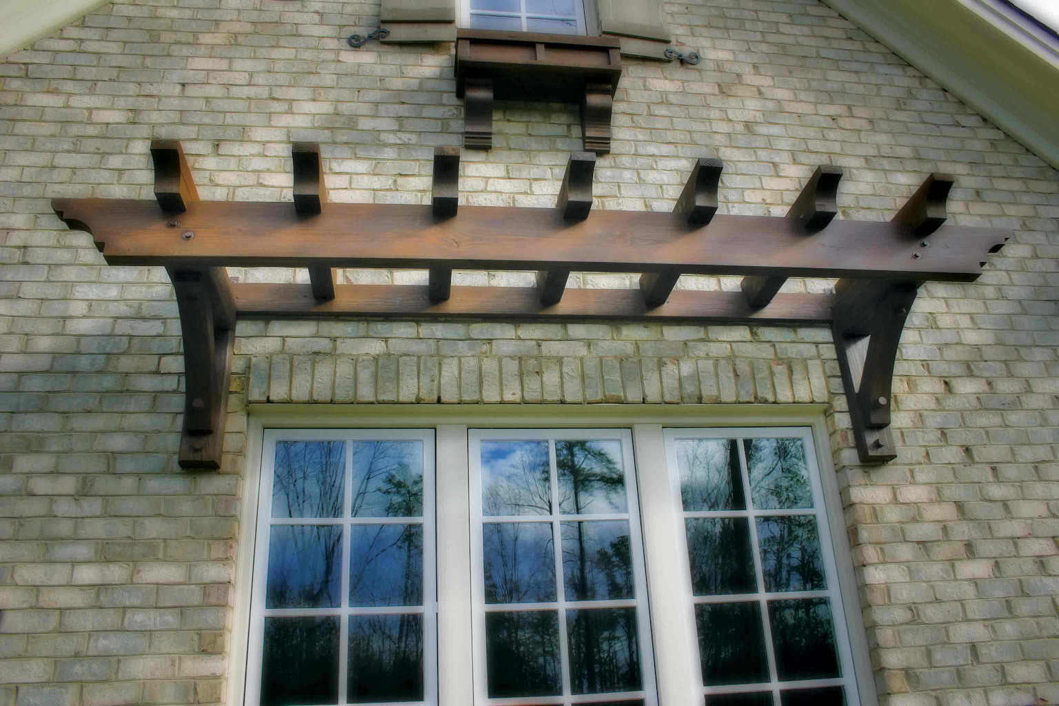 This wood trellis is a great accent over this window.